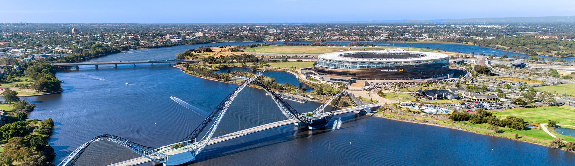 A view of the Swan River in Perth WA, the Optus Stadium is in background.